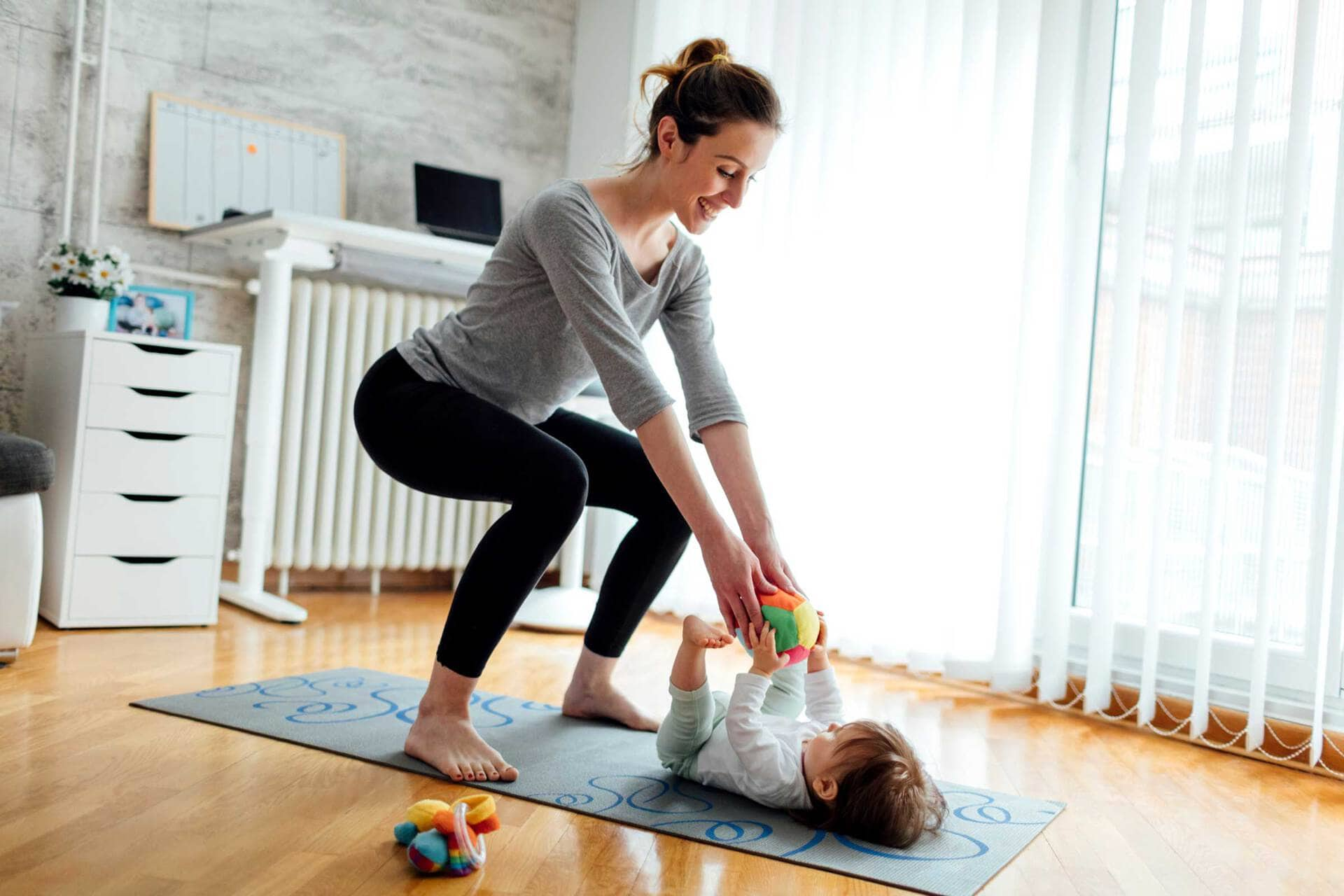 Mom exercising with baby